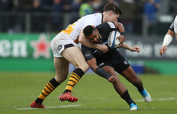 Bath's Aled Brew is tackled by Wasps Ross Neal during the Heineken Champions Cup match at the Recreation Ground, Bath.