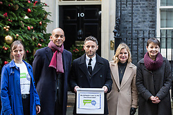 London, UK. 3rd December, 2018. A group including People's Vote spokesman Chuka Umunna MP, editor of the Independent Christian Broughton, Justine Greening MP and Caroline Lucas MP delivers a Final Say petition signed by over a million people to 10 Downing Street to be presented to Prime Minister Theresa May following her return from the G20 summit in Buenos Aires.