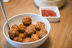 Close-up of meatballs with tomato sauce, Munich, Germany
