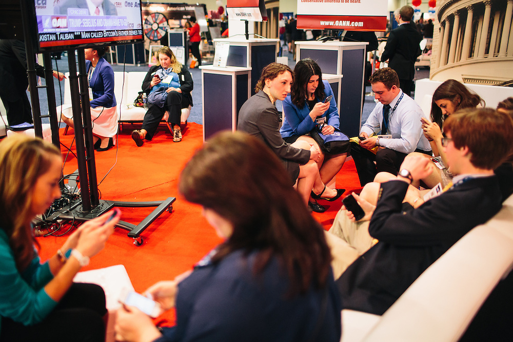 """Republican students from Cornell University take a break in a lounge area of the HUB during day two of the Conservative Political Action Conference (CPAC) at the Gaylord National Resort & Convention Center in National Harbor, Md. """"The unemployment rate for recent grads is very high,"""" said Jessica Reif, 22, in blue blazer in the center, who explained that young conservatives tend to be characterized by fiscal conservatism. """"We are worried about our job prospects after graduation."""""""