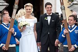 16.04.2011, Going am Wilden Kaiser, Tirol, AUT, kirchliche Trauung von Maria Riesch und Markus Höfl in der Pfarrkirche zum Hl. Kreuz, im Bild die Skirennfahrerin Maria Höfl-Riesch und ihr Ehemann Marcus Höfl verlassen nach der Taruung die Kirche // the german skieracer Maria Riesch-Hoefl and her husband Marcus Hoefl during church wedding at Church of the Holy Cross in Going, Austria on 16/4/2011. EXPA Pictures © 2011, PhotoCredit: EXPA/ J. Groder / SPORTIDA PHOTO AGENCY
