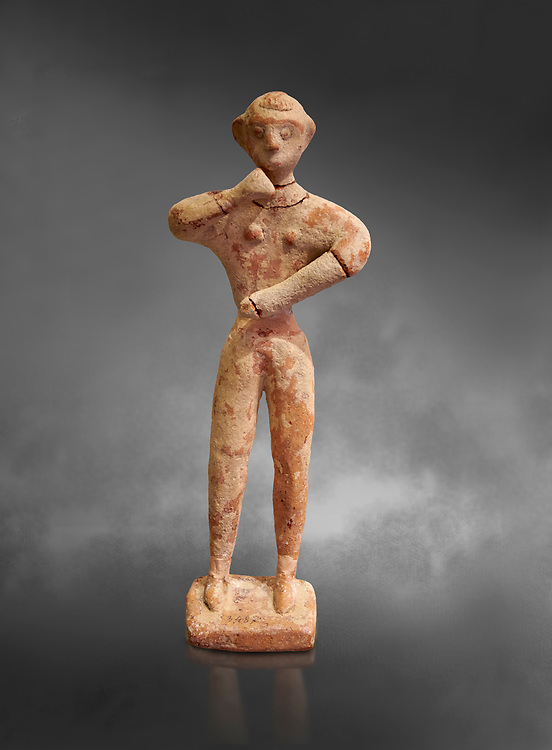 Minoan clay male figurine in the attitude of worship, Chamezi 1900-1700 BC; Heraklion Archaeological  Museum, grey background. .<br /> <br /> If you prefer to buy from our ALAMY PHOTO LIBRARY  Collection visit : https://www.alamy.com/portfolio/paul-williams-funkystock/minoan-art-artefacts.html . Type -   Heraklion   - into the LOWER SEARCH WITHIN GALLERY box. Refine search by adding background colour, place, museum etc<br /> <br /> Visit our MINOAN ART PHOTO COLLECTIONS for more photos to download  as wall art prints https://funkystock.photoshelter.com/gallery-collection/Ancient-Minoans-Art-Artefacts-Antiquities-Historic-Places-Pictures-Images-of/C0000ricT2SU_M9w