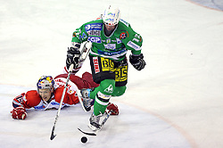 Jussi Tarvainen of Salzburg and Todd Elik of Olimpija at sixth game of the Final of EBEL league (Erste Bank Eishockey Liga) between ZM Olimpija vs EC Red Bull Salzburg,  on March 25, 2008 in Arena Tivoli, Ljubljana, Slovenia. Red Bull Salzburg won the game 3:2 and series 4:2 and became the Champions of EBEL league 2007/2008.  (Photo by Vid Ponikvar / Sportal Images)..