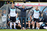 Gareth Ainsworth, the Wycombe Wanderers manager © reacts in the dugout. Skybet football league two match, Wycombe Wanderers  v AFC Wimbledon at Adams Park  in High Wycombe, Buckinghamshire on Saturday 2nd April 2016.<br /> pic by John Patrick Fletcher, Andrew Orchard sports photography.