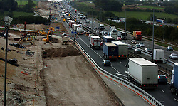 Embargoed to 0001 Thursday October 13<br /> File photo dated 9/10/2006 of construction work by a motorway. Cancelled and delayed infrastructure projects are costing the UK economy £48,000 a minute, a report warns.