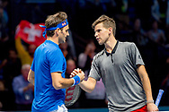 Roger Federer of Switzerland shakes hands with Dominic Thiem of Austria after winning his match during the Nitto ATP World Tour Finals at the O2 Arena, London, United Kingdom on 13 November 2018.Photo by Martin Cole