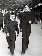 two soldiers buddies walking Europe France 1949