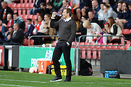 Swindon Town Manager Mark Cooper takes a drink while looking on. Skybet football league 1 match, Crewe Alexandra v Swindon Town at The Alexandra Stadium in Crewe, Cheshire on Saturday 5th September 2015.<br /> pic by Chris Stading, Andrew Orchard sports photography.