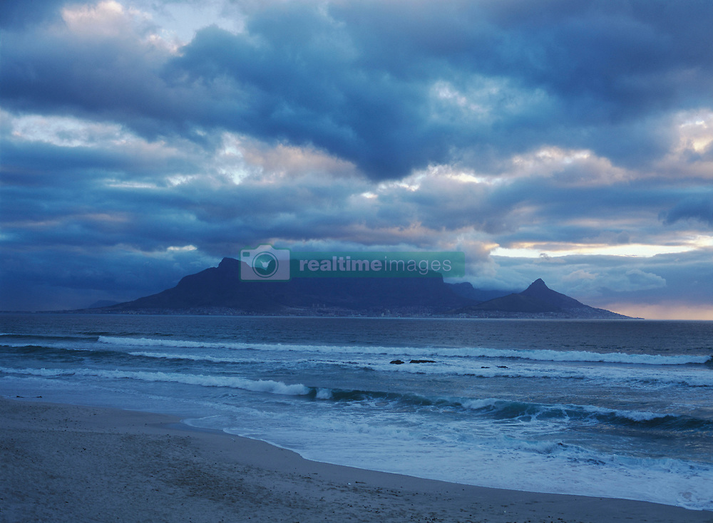 Looking over to Cape Town and Table Mountain at dusk from Blouberg Beach, South Africa. (Credit Image: © Axiom/ZUMApress.com)