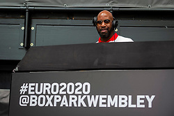 © Licensed to London News Pictures. 13/06/2021. LONDON, UK. DJ Spoony entertains jubilant England fans at Boxpark Wembley for the England v Croatia match at Wembley Stadium for the 2020 UEFA European Football Championship, commonly known as Euro 2020. The tournament was postponed from 2020 due to the COVID-19 pandemic in Europe and rescheduled for 11 June to 11 July 2021 with matches to be played in 11 cities. Wembley Stadium will host certain group matches, as well as the semi-finals and final itself.  Photo credit: Stephen Chung/LNP