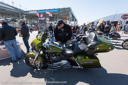 There was a chill in the air for the early morning crowds, but it didn't damper their enthusiasm for the new bikes at the Harley-Davidson display at the Dayton Speedway during Daytona Bike Week. Daytona Beach, FL. USA. Wednesday March 15, 2017. Photography ©2017 Michael Lichter.