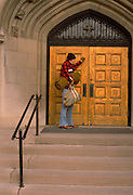 50 year old homeless person knocking on the front door of a church.  St Paul Minnesota USA