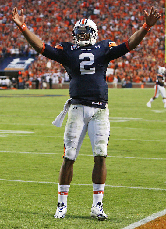AUBURN - OCTOBER 16:  Quarterback Cam Newton #2 of the Auburn Tigers celebrates during the game against the Arkansas Razorbacks at Jordan-Hare Stadium on October 16, 2010 in Auburn, Alabama.  The Tigers beat the Razorbacks 65-43 in the highest scoring SEC game in history.  (Photo by Mike Zarrilli/Getty Images) *** Local Caption *** Cam Newton
