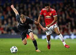 CSKA Moscow's Vasili Berezutski (left) and Manchester United's Marcus Rashford battle for the ball during the UEFA Champions League match at Old Trafford, Manchester.