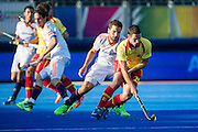 Spain's Pau Quemada is watched by Valetin Verga of the Netherlands. Netherlands v Spain - Unibet EuroHockey Championships, Lee Valley Hockey & Tennis Centre, London, UK on 21 August 2015. Photo: Simon Parker