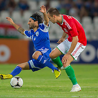 Israel's Lior Refaelov! (L) and Hungary's Peter Szakaly (R) fights for the ball during a friendly football match Hungary playing against Israel in Budapest, Hungary on August 15, 2012. ATTILA VOLGYI