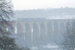 Licensed to London News Pictures 28/01/2018<br /> A train passes over Crimple Valley Viaduct in near white-out conditions just south of Harrogate, North Yorkshire<br /> Photo Credit: Sam Atkins/LNP