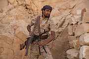 """Mcc0081437 . Daily Telegraph<br /> <br /> DT Foreign<br /> <br /> Yemeni government soldiers on the frontline in the Fardah mountains overlooking the village of Al Hatem on the road to the Houthi rebel held capital of Sanaa . <br /> <br /> Yemen has been in the midst of a civil war since 2015 when the President Abdrabbuh Mansur Hadi was forced to flee . A Saudi led coalition with 9 other Arab states  named """"Operation Decisive Storm """"  has since sought to restore Hadi with little effect .<br /> <br /> <br /> Yemen 22 February"""