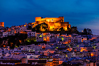 The town of Salobrena on the Costa Tropical of Granada Province, Spain with its Moorish castle atop the hill illuminated at twilight.