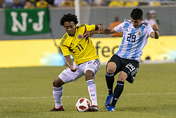 September 11, 2018 - East Rutherford, NJ, U.S. - EAST RUTHERFORD, NJ - SEPTEMBER 11: Colombia midfielder Juan Guillermo Cuadrado (11) battles with Argentina midfielder Ezequiel Palacios (29) during the first half of the International Friendly Soccer match between Argentina and Colombia on September 11, 2018 at MetLife Stadium in East Rutherford, NJ. (Photo by John Jones/Icon Sportswire) (Credit Image: © John Jones/Icon SMI via ZUMA Press)