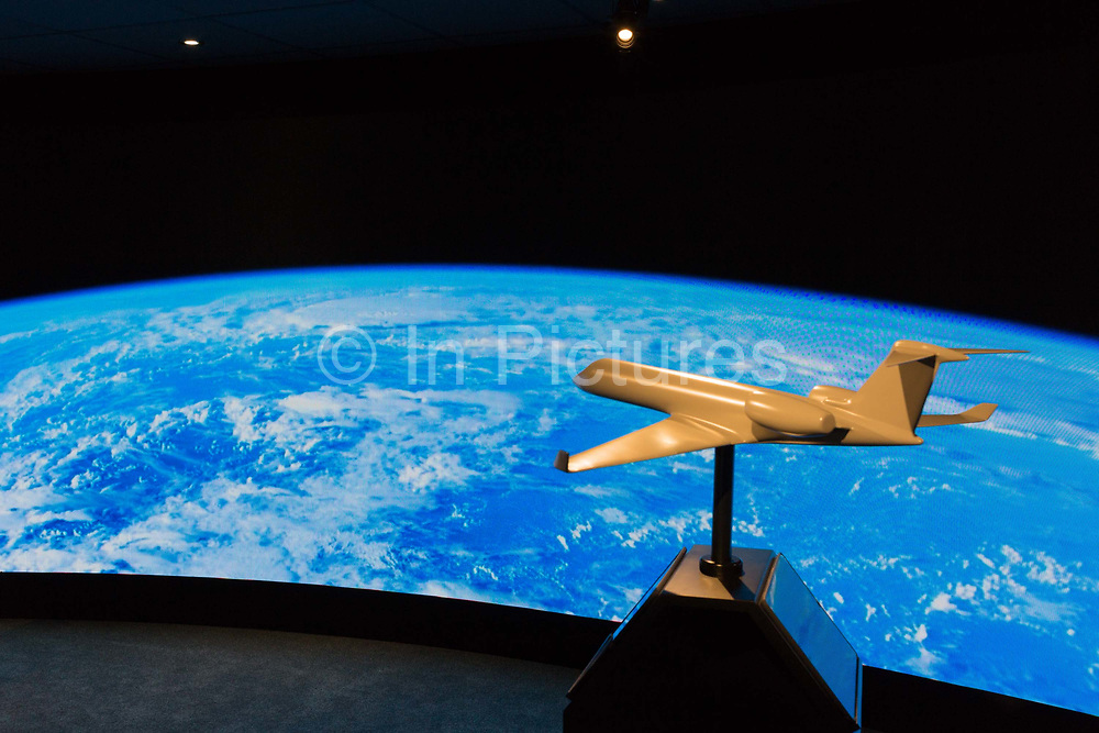 A model of a generic aircraft and the images from a video presentation in the exhibition chalet of United Technologies, at the Farnborough Airshow, on 16th July 2018, in Farnborough, England. United Technologies are the parent company to  Otis, UTC Climate, Controls & Security and Pratt & Whitney.