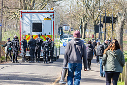 © Licensed to London News Pictures. 09/03/2021. London, UK. Members of a specialist police diving unit get kitted up before they search ponds on Clapham Common this morning as the hunt for missing Londoner, Sarah Everad 33 continues. Sarah Everad from Brixton disappeared while walking home from a friend's house in Clapham and was last seen by CCTV around 9.30pm on Poynder's Road SW4 heading towards Tulse Hill. Photo credit: Alex Lentati/LNP