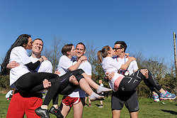 © Licensed to London News Pictures. 16/03/2014. Dorking, UK. The 7th UK Wife Carrying Race. Males or females carry a 'wife' over a 380M course which features obstacles and water hazards. The wives must be at least 18yrs old, male or female and weigh at least 50kg. Picture shows (L-R) 2nd place Vytautas Kirkliauskas and wife Neringa, Winner Rich Blake Smith carrying Anna and 3rd placed Benjamin Hall with Gemma Taylor. Photo credit : Julie Edwards/LNP