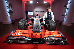 © Licensed to London News Pictures. 18/05/2021. LONDON, UK. A technician polishes Lewis Hamilton's Formula 1 race winning car which will be auctioned by RM Sotheby's at the 2021 British Grand Prix.  The 2010 McLaren Mercedes MP4-25A Formula Race Car has an estimate of $5m to $7m and is the first ever Lew Hamilton F1 Race Car as well as the first ever Grand Prix winning car to be offered for public sale.  Photo credit: Stephen Chung/LNP
