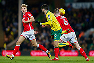 Barnsley defender Liam Lindsay (6) makes a tackle Norwich City striker Nelson Oliveira (9) during the EFL Sky Bet Championship match between Norwich City and Barnsley at Carrow Road, Norwich, England on 18 November 2017. Photo by Phil Chaplin.