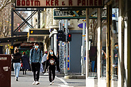 A view of a man and woman wearing a facemask walking along Lygon Street during COVID-19. A further 238 Coronavirus cases have been discovered overnight, bringing Victoria's active cases to over 2000, speculation is rising that almost all of Victoria's current cases stem from the Andrews Government botched hotel quarantine scheme as well as the Black Lives Matter protest.  Premier Daniel Andrews warns that Victoria may go to Stage 4 lockdown if these high numbers continue. (Photo be Dave Hewison/ Speed Media)
