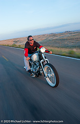 Brian Klock rides through the Badlands, SD. Photographed during the annual Sturgis Rally and Races August 14, 2004.  Photography ©2004 Michael Lichter.