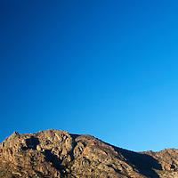Mexico, Baja California Sur, Loreto. Moon over Baja landscape at Villa del Palmar Loreto.