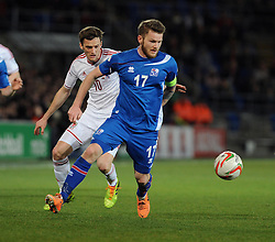 Aron Einar Gunnarson (Cardiff City) of Iceland  is chased down by Andy King of Wales (Leicester City) - Photo mandatory by-line: Dougie Allward/JMP - Tel: Mobile: 07966 386802 03/03/2014 -