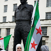 Syrian women gathered next to the statue of General Montgomery, 1. Viscount of Alamein at an Anti-Assad Syrian demonstration held in Whitehall, Central London. The demonstration was called by the Syrian Community in the UK under the head lines; Syrians are being killed in a genocide and the world is watching. Several hundreds gathered opposite Downing Street 10 calling for Syrians to unite and the world to intervene.