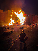 Bonfires are built in Protestant areas right across Northern Ireland and lit on the eve of 12 July Orange celebrations. This one is on Sandy Row in the heart of Belfast, right next The Holiday Inn.
