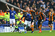 Idrissa Gueye of Everton looks to get away from Sam Clucas of Hull City. Premier league match, Everton v Hull city at Goodison Park in Liverpool, Merseyside on Saturday 18th March 2017.<br /> pic by Chris Stading, Andrew Orchard sports photography.