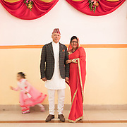The groom's father and his wife. Wedding participant poses for a portrait during the reception.