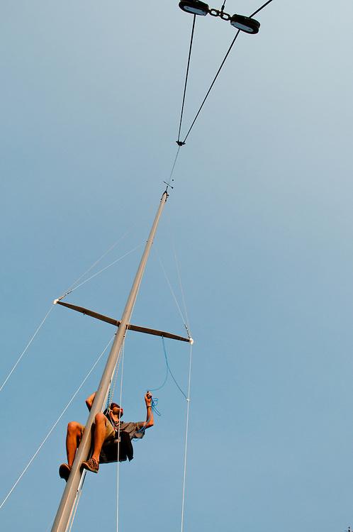 My friend Nick climbing the mast of his sailboat on Elliot Bay, Seattle, Washington
