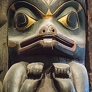 A likeness of a grizzly bear that forms the lower portion of a Tsimshian Totem Pole from the 19th century from the American Northwest Coast. It's on display at the Smithsonian National Museum of Natural History on the National Mall in Washington DC.