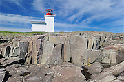 Grand Passage Lighthouse and rock landscape<br /> Brier Island on the Digby Neck<br /> Nova Scotia<br /> Canada