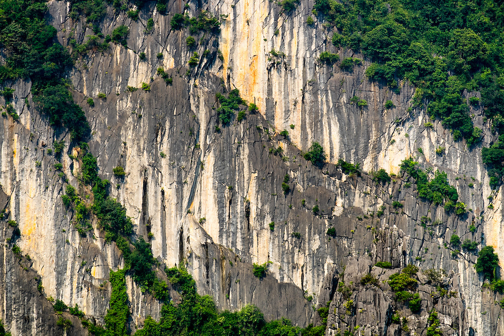 HA LONG BAY, VIETNAM - CIRCA SEPTEMBER 2014:  Detail of  limestone karsts from one of the thousand islands on Ha Long Bay in Vietnam, a popular tourist destination.