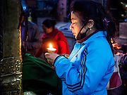 07 MARCH 2017 - KATHMANDU, NEPAL:  A woman prays at the Kamaladi Ganesh Temple, the most important Hindu temple dedicated to Ganesh, known as the overcomer of obstacles, in Kathmandu. In Hindu theology, Tuesdays are the best day to pray to Ganesh and the temple is very busy on Tuesdays. People frequently visit temples dedicated to Ganesh when they buy a new home or start a new job.    PHOTO BY JACK KURTZ