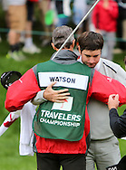 28 JUN 15 Caddie Ted Scott celebrates with Bubba Watson on 18 at the conclusion of Sunday's Final Round at The Travelers Championship at TPC River Highlands in Cromwell,Conn. (photo credit : kenneth e. dennis/kendennisphoto.com)