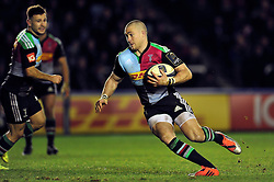Mike Brown of Harlequins takes on the Wasps defence - Photo mandatory by-line: Patrick Khachfe/JMP - Mobile: 07966 386802 17/01/2015 - SPORT - RUGBY UNION - London - The Twickenham Stoop - Harlequins v Wasps - European Rugby Champions Cup