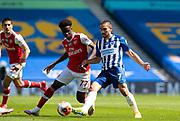 20th June 2020, American Express Stadium, Brighton, Sussex, England: Premier League football, Brighton v Arsenal.<br /> Saka challenges Neal Maupay.