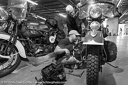 "Father and son working together - Matt McManus working on his 1936 Harley-Davidson Knucklehead beside his dad Ken McManus (who runs an exactly identical machine) on the  Friday ""Rest Day"" between stages 7 and 8 of the Motorcycle Cannonball Cross-Country Endurance Run in Junction City, KS., USA. Friday, September 12, 2014.  Photography ©2014 Michael Lichter."