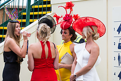 Ascot, UK. 20 June, 2019. Racegoers wearing fancy hats and fascinators attend Ladies Day at Royal Ascot.