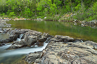 The peaceful Black River winds its way through the Saint Francois Mountains before it reached a series of waterfalls. These waterfalls are known as shut-ins.<br /> <br /> Date Taken: May 7, 2014