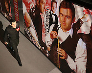 Ronnie O'Sullivan (Eng) walks past a large picture of himself as he enters the area after the break. Ronnie O'Sullivan v Liang Wenbo, 1st round match at the Dafabet Masters Snooker 2017, day 1 at Alexandra Palace in London on Sunday 15th January 2017.<br /> pic by John Patrick Fletcher, Andrew Orchard sports photography.