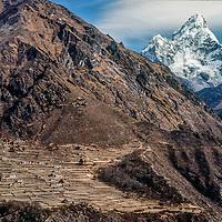 Ama Dablam rises behind Phortse village in the Khumbu region of Nepal's Himalaya.